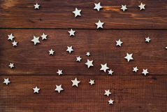 Brown wooden background with wooden stars Stock Photography