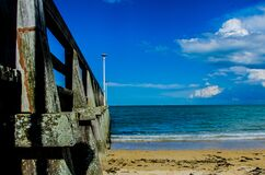 Brown Wooden Bar Near Sea Shore Under Blue Sky during Day Time royalty free stock images
