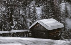 Brown Wooden Barn during Snow Royalty Free Stock Image