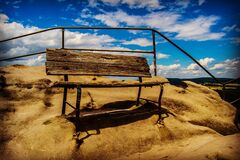 Brown Wooden Bench on Brown Sand Stock Photo