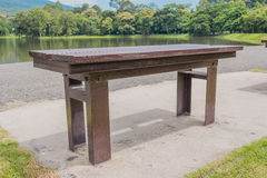 brown wooden bench at a green lake Royalty Free Stock Photography