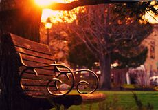 Brown Wooden Bench on Sunset Stock Photos