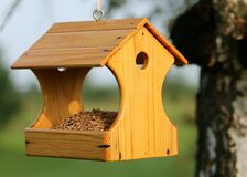 Brown Wooden Bird House Hanging on Tree Stock Image