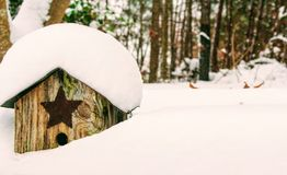 Brown Wooden Birdhouse Covered With Snow Stock Photos