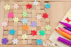 Brown wooden blocks with flowers Royalty Free Stock Photography