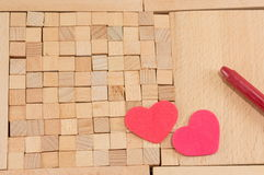 Brown wooden blocks with hearts Royalty Free Stock Photo