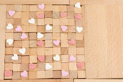 Brown wooden blocks with hearts Stock Photography