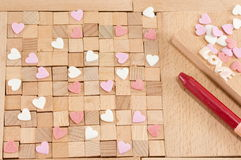 Brown wooden blocks with hearts Royalty Free Stock Image