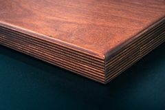 Brown Wooden Board Near Black Surface royalty free stock photos