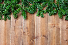 Brown wooden  boards and and green christmas tree Royalty Free Stock Image