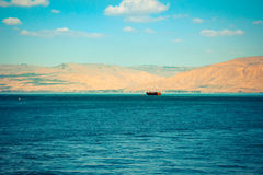 Brown wooden boat sailing in Sea of Galilee.  Royalty Free Stock Photo