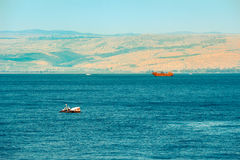 Brown wooden boat sailing in Sea of Galilee Stock Images