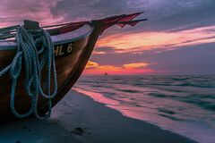 Brown Wooden Boat on Shore during Sunset Stock Photography