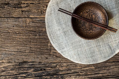 The brown wooden bowl on a rustic table closeup,wooden backgroun Royalty Free Stock Image