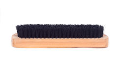 Brown wooden brush. Isolated on white background royalty free stock image