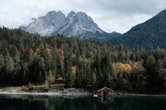 Brown Wooden Cabin in a Lake Royalty Free Stock Photo
