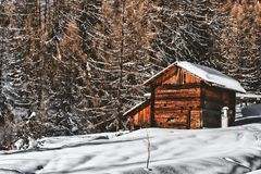 Brown Wooden Cabin In Snowy Landscape Near Forest Royalty Free Stock Images
