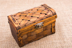Brown wooden case on brown fabric. Background Royalty Free Stock Images