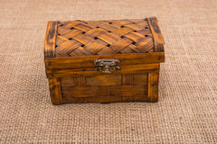 Brown wooden case on brown fabric. Background Royalty Free Stock Photo