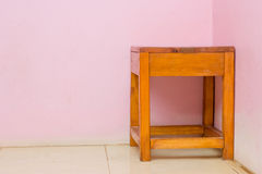 Brown wooden chair with pink walls Royalty Free Stock Photo