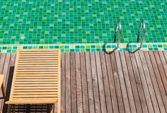 Brown wooden chairs side swimming pool. Royalty Free Stock Photos