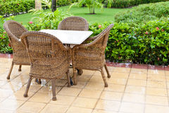 Brown wooden chairs an tables on patio Stock Photo