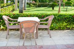 Brown wooden chairs an tables on patio Royalty Free Stock Images
