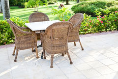 Brown wooden chairs an tables on patio Stock Photos