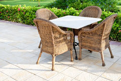 Brown wooden chairs an tables on patio Royalty Free Stock Image