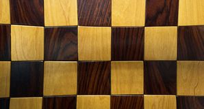 Brown wooden chess game board. Above top view. Checker surface pattern stock image