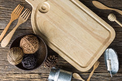 The brown wooden chopping board on a rustic table Stock Photography