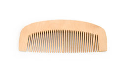 Brown wooden comb. On a white background Royalty Free Stock Images