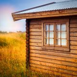 Brown Wooden Cottage at the Field during Day Royalty Free Stock Photography