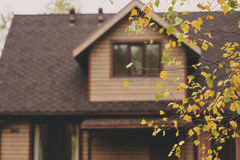 Brown wooden country house in autumn. Evening Royalty Free Stock Images