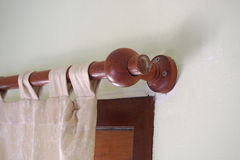 Brown wooden curtain rail Stock Image