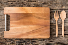 The brown wooden Cutting board  on a rustic table closeup,wooden Stock Photography