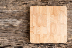 The brown wooden Cutting board  on a rustic table closeup,wooden. The brown wooden Cutting board  on a rustic table closeup.  Top View with Copy Space for Text Royalty Free Stock Photo