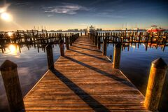 Brown Wooden Dock on Blue Water Under White Clouds and Blue Sky during Daytime Royalty Free Stock Photos