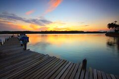 Brown Wooden Dock on Body of Water during Twilight Royalty Free Stock Image
