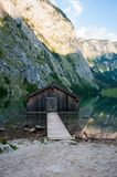 Brown Wooden Dock Near Rocky Cliff Stock Images