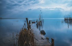Brown Wooden Dock during Sunset Stock Images