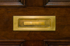 Brown Wooden Door Closed Mailslot Golden Metal Closeup Texture P. Ost Royalty Free Stock Images