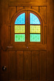 Brown wooden door with colorful stained glass Stock Photography