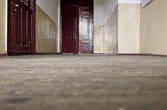Brown wooden door and dusty old wooden floor Royalty Free Stock Photo