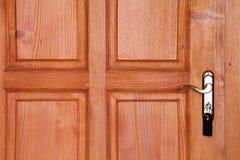 Brown wooden door with handle and key Stock Photo