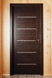 Brown wooden door inside of wooden house Royalty Free Stock Photo