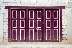 Brown wooden door Stock Image