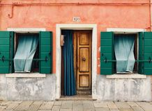 Brown Wooden Door Opened With Green Window Curtains stock photography