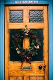 Brown Wooden Door With Pine Cone Wreath Royalty Free Stock Image
