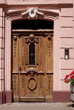 Brown wooden door with woodcraft Royalty Free Stock Photography